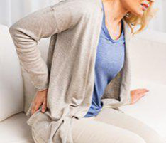 a woman experiencing back pain