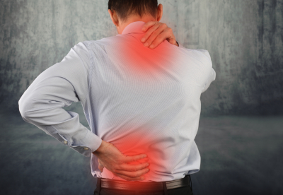 business man suffering from neck and back pain