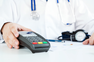doctor holding credit card reader